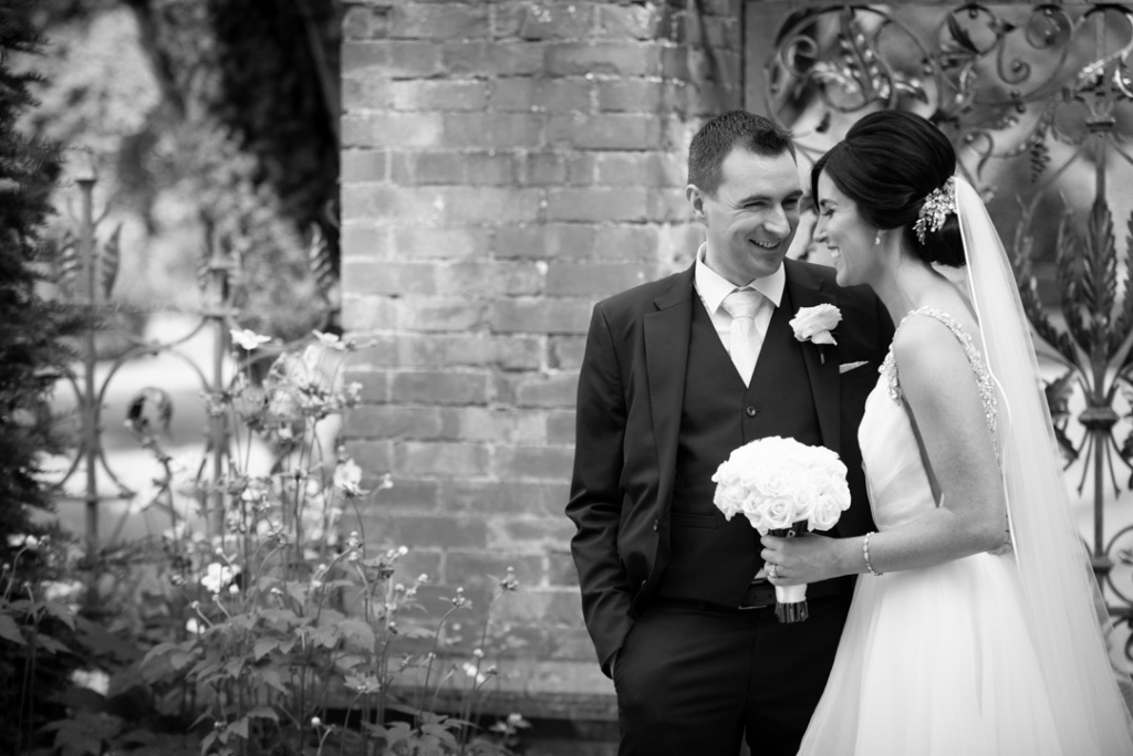 Bride and Groom laughing in the gardens of Tankardstown House