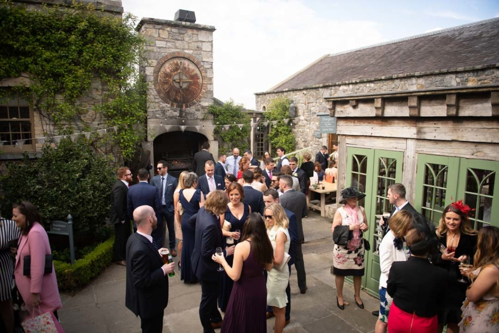 Wedding guests outside at the drinks reception at the Cliff at Lyons wedding venue in Ireland