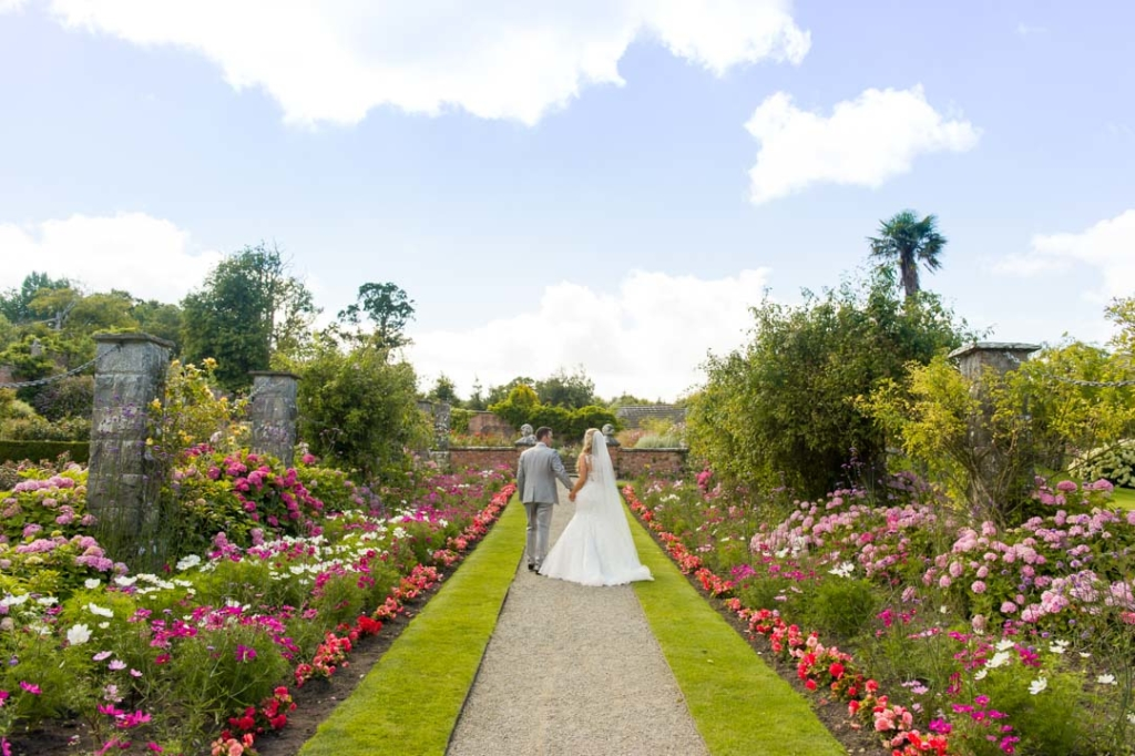 Bride and groom walking through the gardens at Dromoland Castle in Ireland