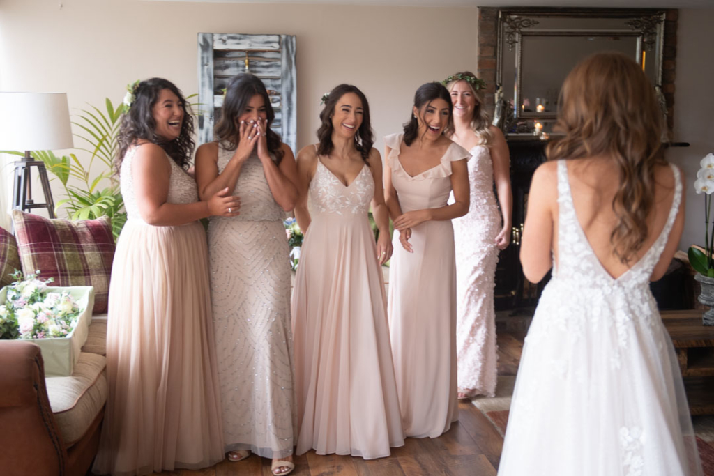 Bridesmaids seeing Bride for the first time in her wedding dress