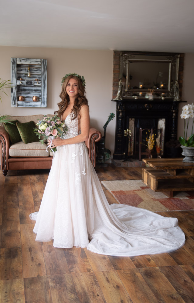 Bride in her blush wedding dress holding her flowers in ballymagarvey