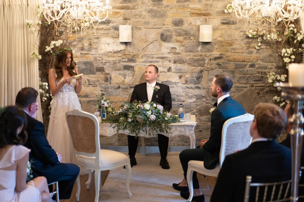 Bride giving her speech during the wedding ceremony at Ballymagarvey Village
