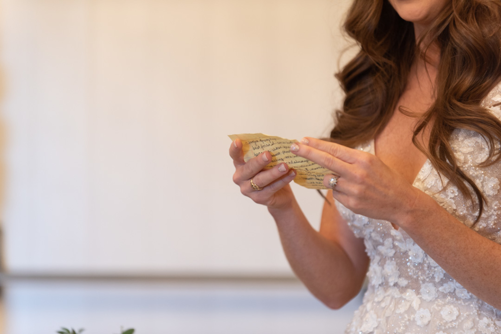 Bride holding her hand written speech