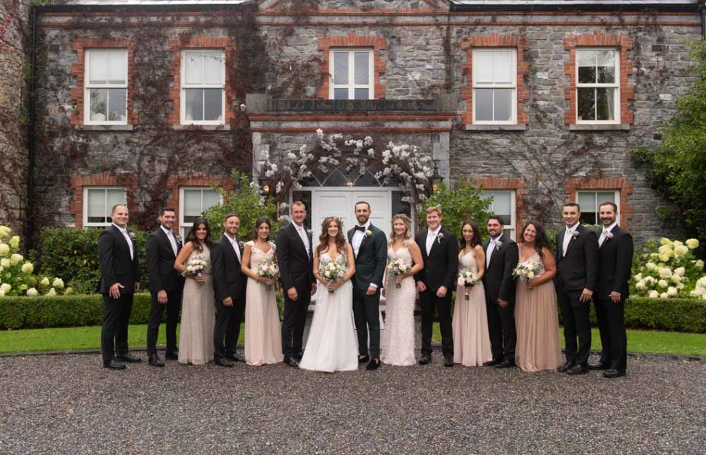 Bridal party standing in front of the house at Ballymagarvey Village