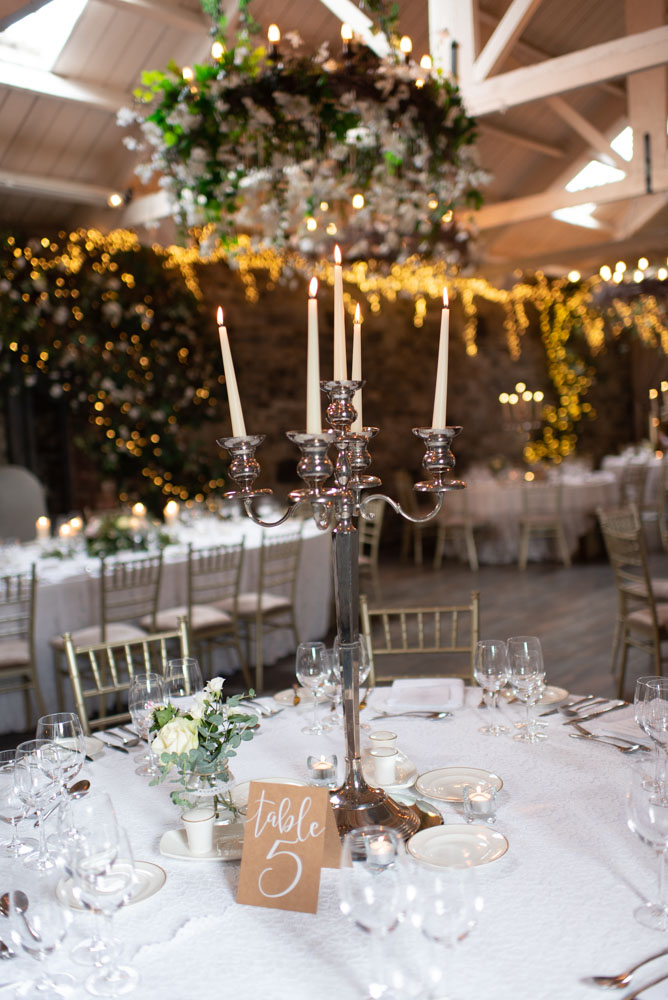 Silver candelabra with white candles in Ballymagarvey Reception room with summer decor