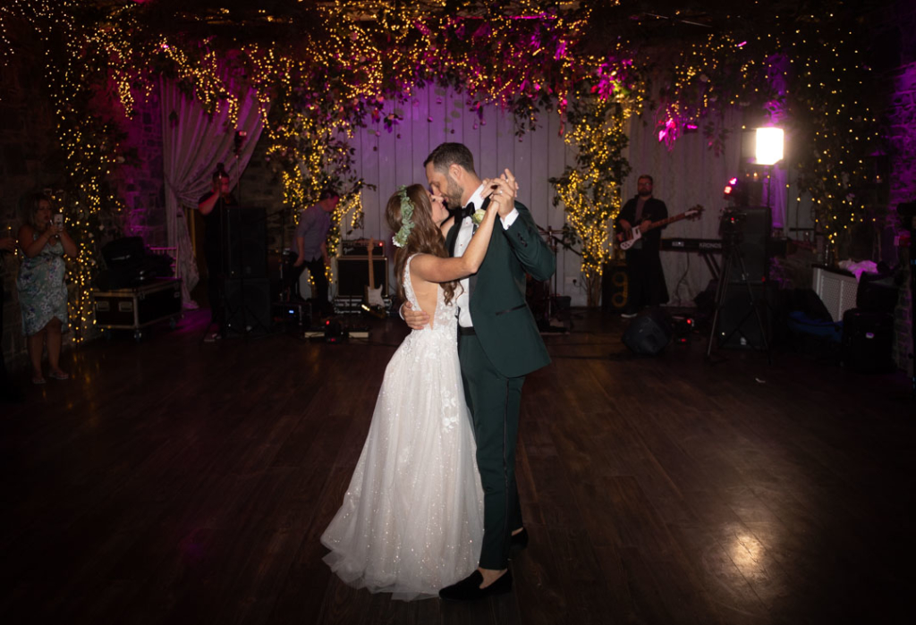Bride and groom having their first dance at Ballymagarvey Village