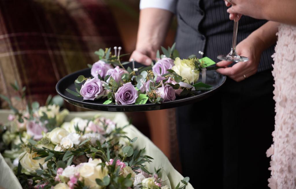 Mauve buttonhole flowers