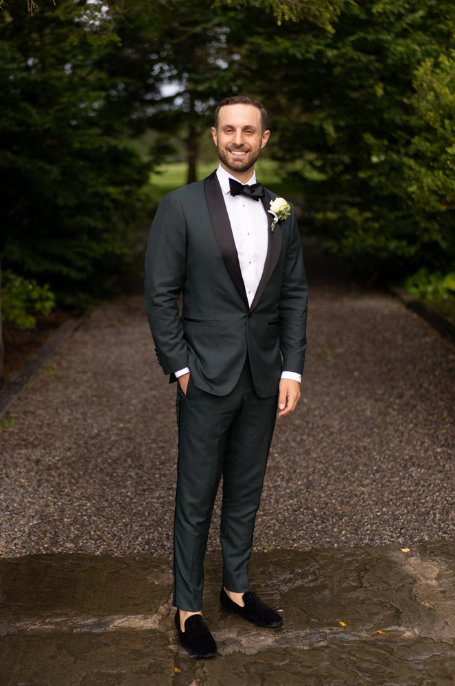 Groom in green suit and black bow tie in Ballymagarvey