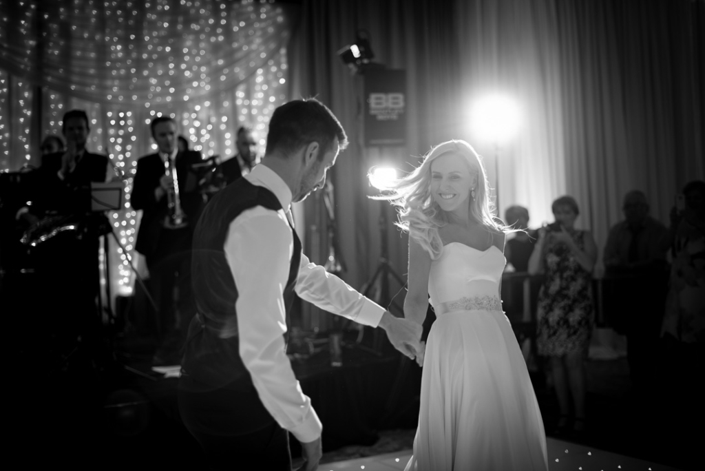 Black and white of bride and groom dancing at the K Club