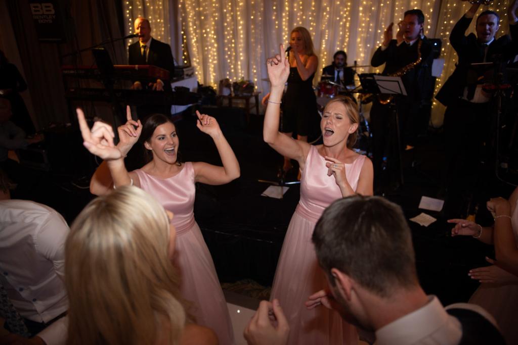 Bridesmaids dancing on the dance floor