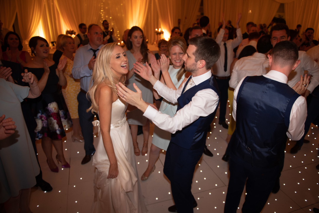 Bride and groom dancing with guests on the dance floor at the K Club