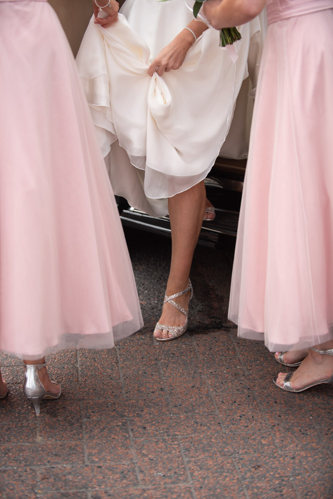 Brides leg and jimmy choo shoe as she steps out to the wedding car