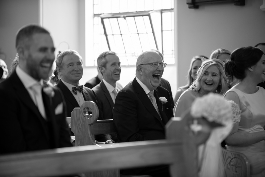 Father of the bride laughing in the Church