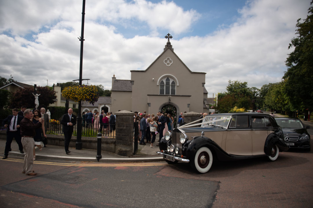 Wedding car and guests outside the Church