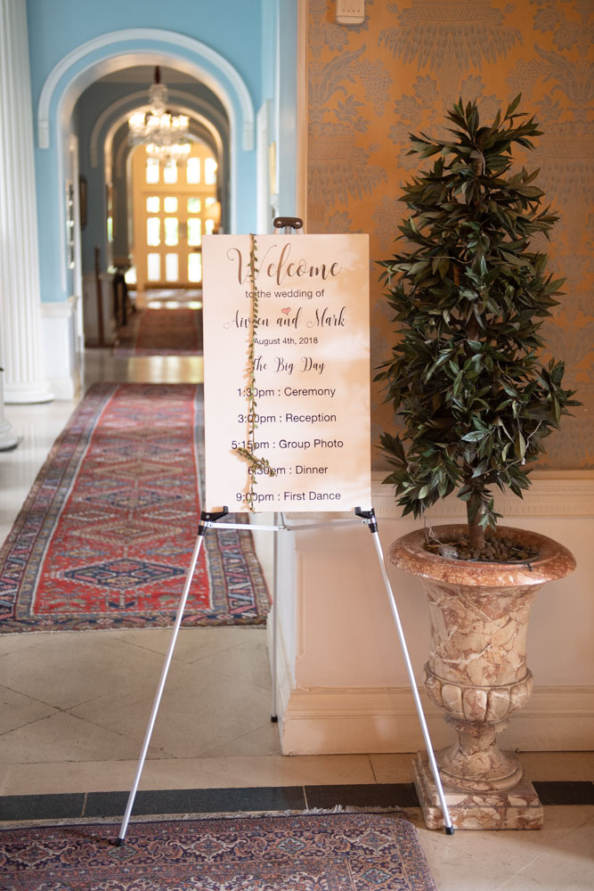 A sign showing the order of the day for the wedding at K Club