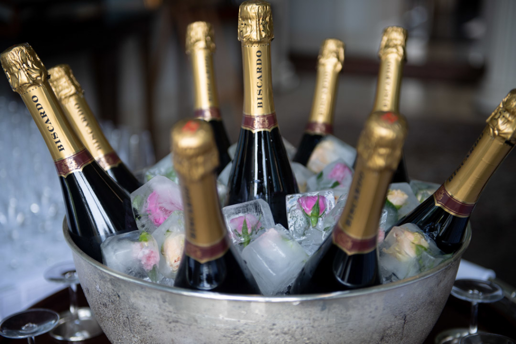 Champagne bottles in ice bucket with flowers frozen in ice cubes at K Club