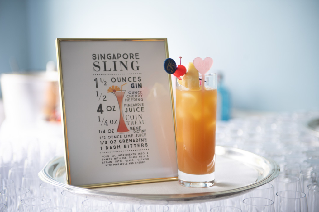 A recipe for a Singapore sling gin drink with a drink beside it