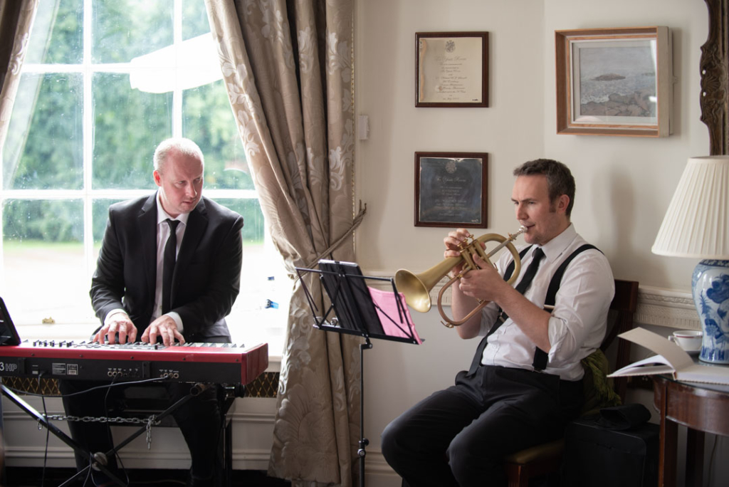 Two musicians playing keyboard and trumpet and wedding in the K Club