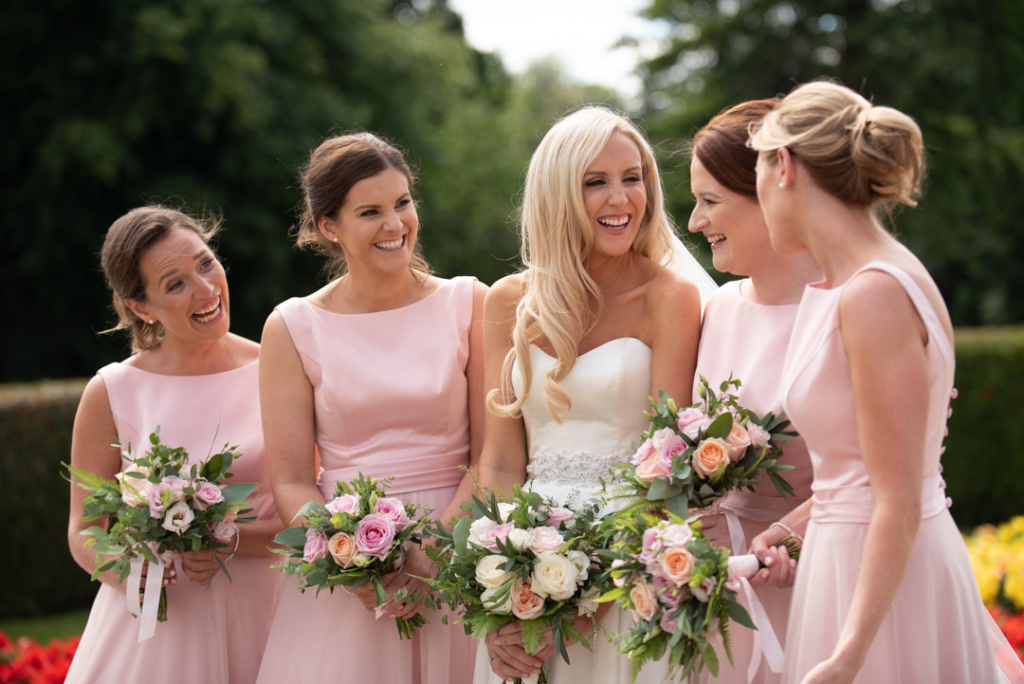 Bride and bridesmaids laughing at the K Club