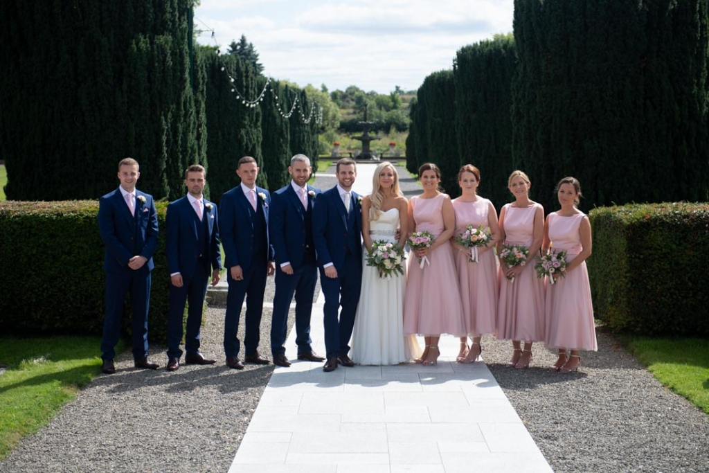 Bride and groom and bridal party in the gardens at the K Club