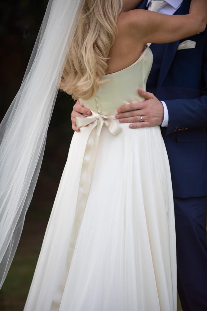 Grooms hands on Brides waist