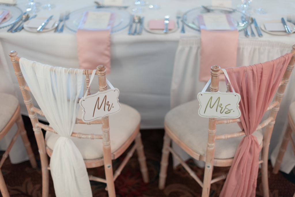 Wedding chairs with Mr and Mrs signs