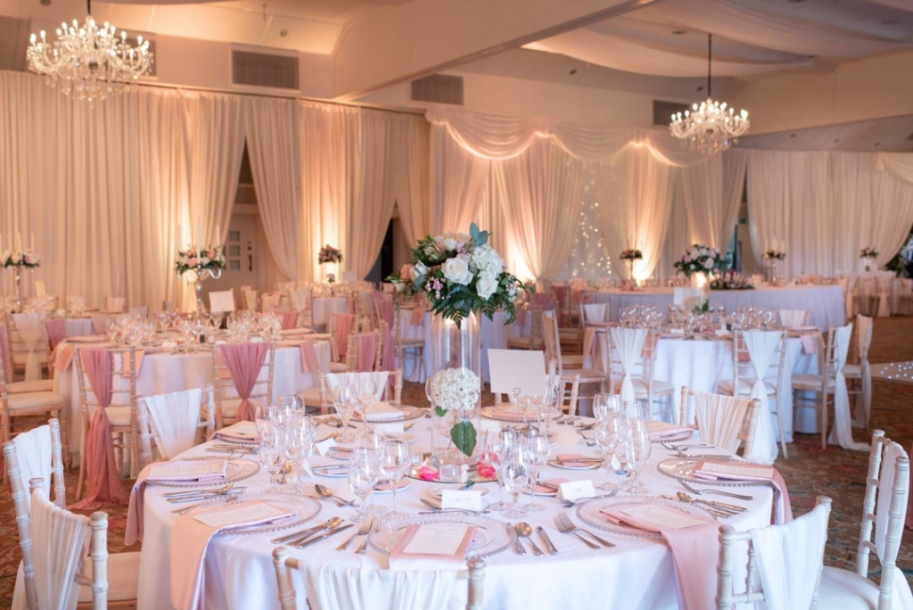 The reception room at the K Club dressed in pink and white for a wedding