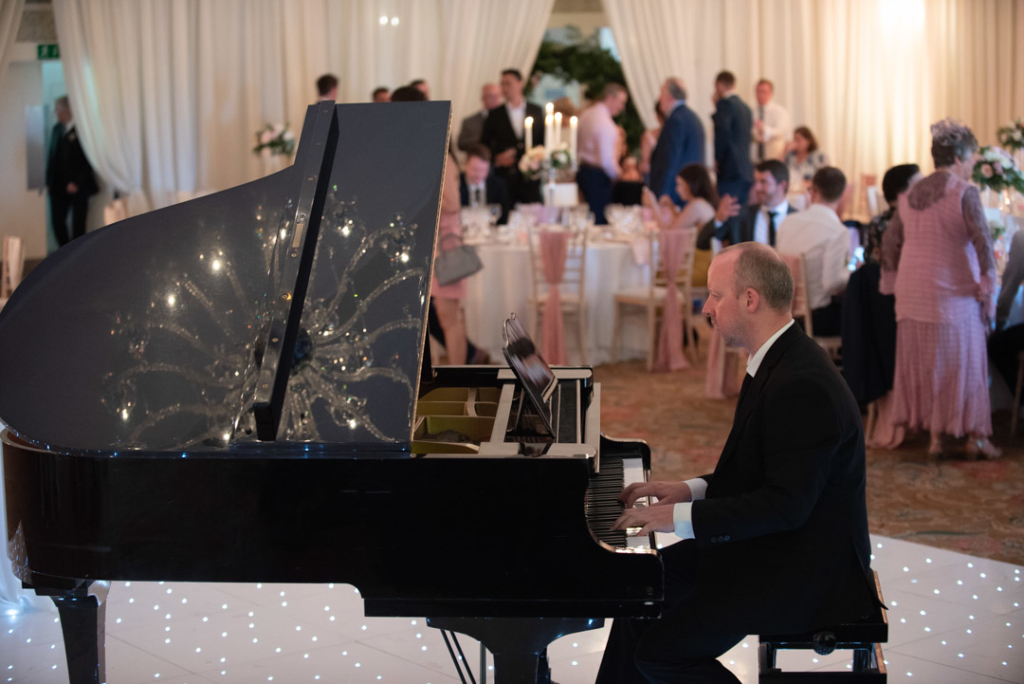 Musician playing grand piano at the dinner reception at the K Club