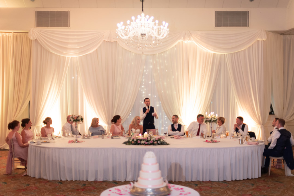 The groom standing at the top table giving his speech