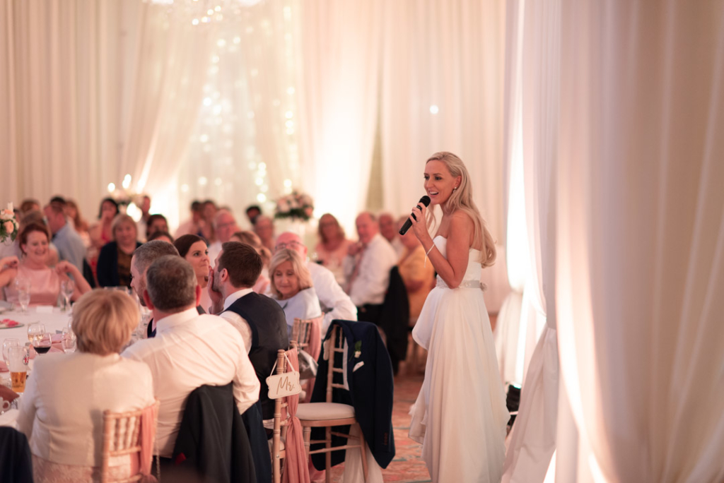 Bride standing at top table and giving a speech