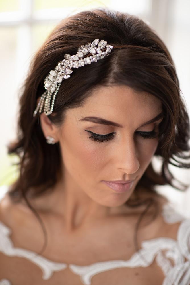 Close up of brides makeup and diamond hair brooch