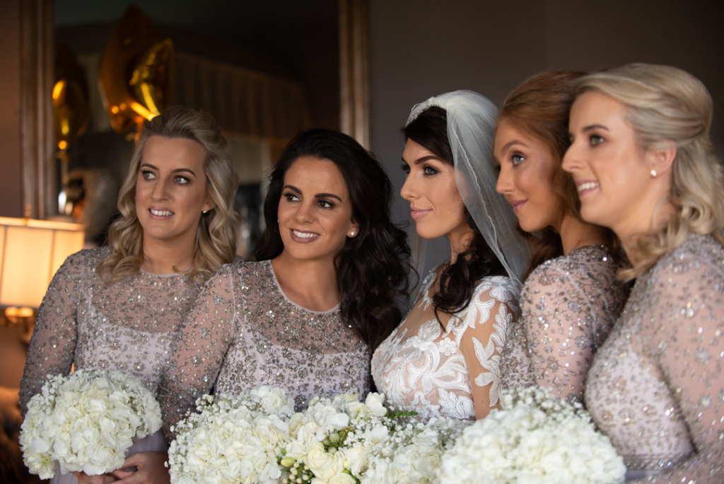 Bride and the bridesmaids holding their flower bouquets
