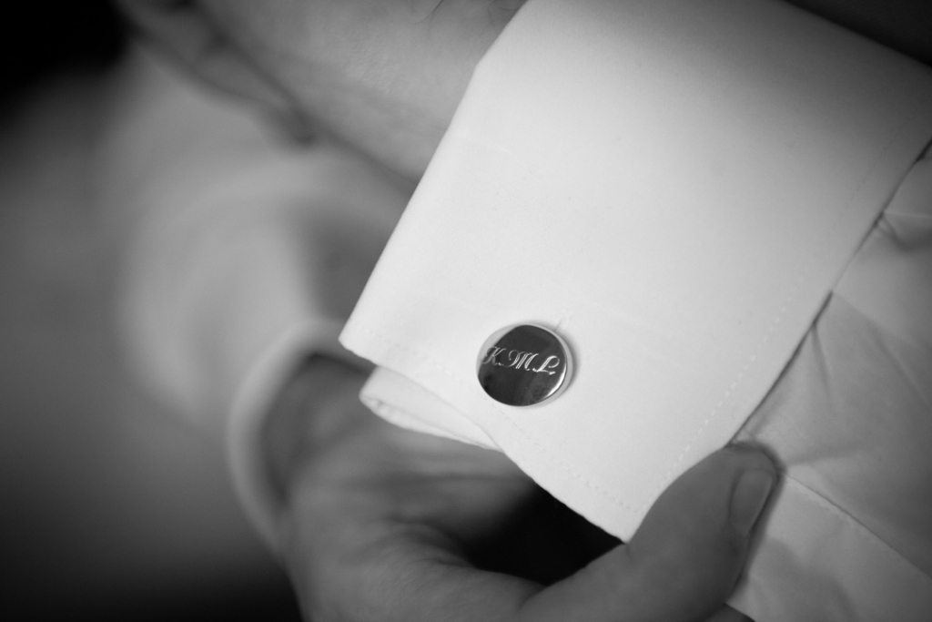 Grooms cuff link with his initials engraved on it