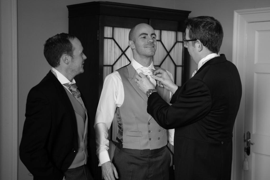 Groomsman fixing the grooms tie at Luttrellstown Castle