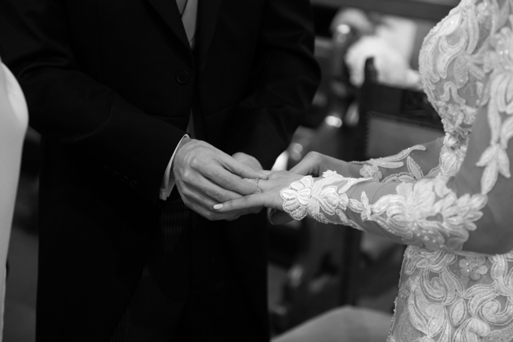 Groom placing the wedding ring on the Brides finger