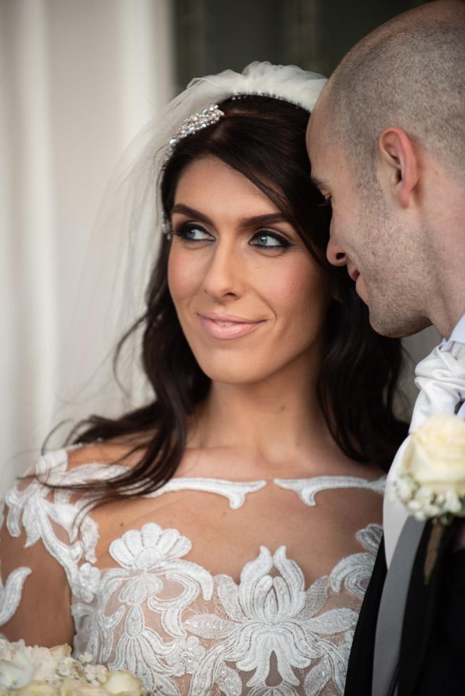 Close up of Bride and Groom looking a Bride