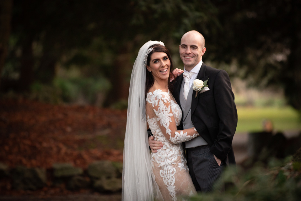 Bride and groom laughing together at their Luttrellstown Castle wedding