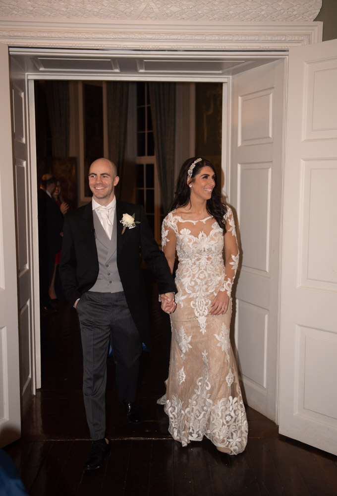 Bride and Groom walking into their dinner reception for their Luttrellstown Castle wedding
