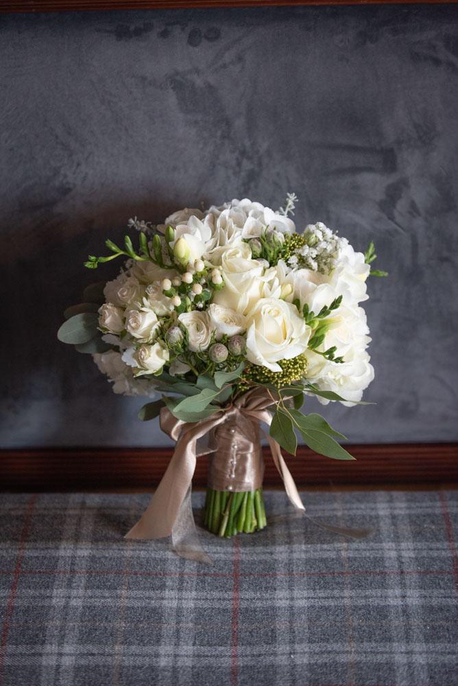 Brides white flower wedding bouquet