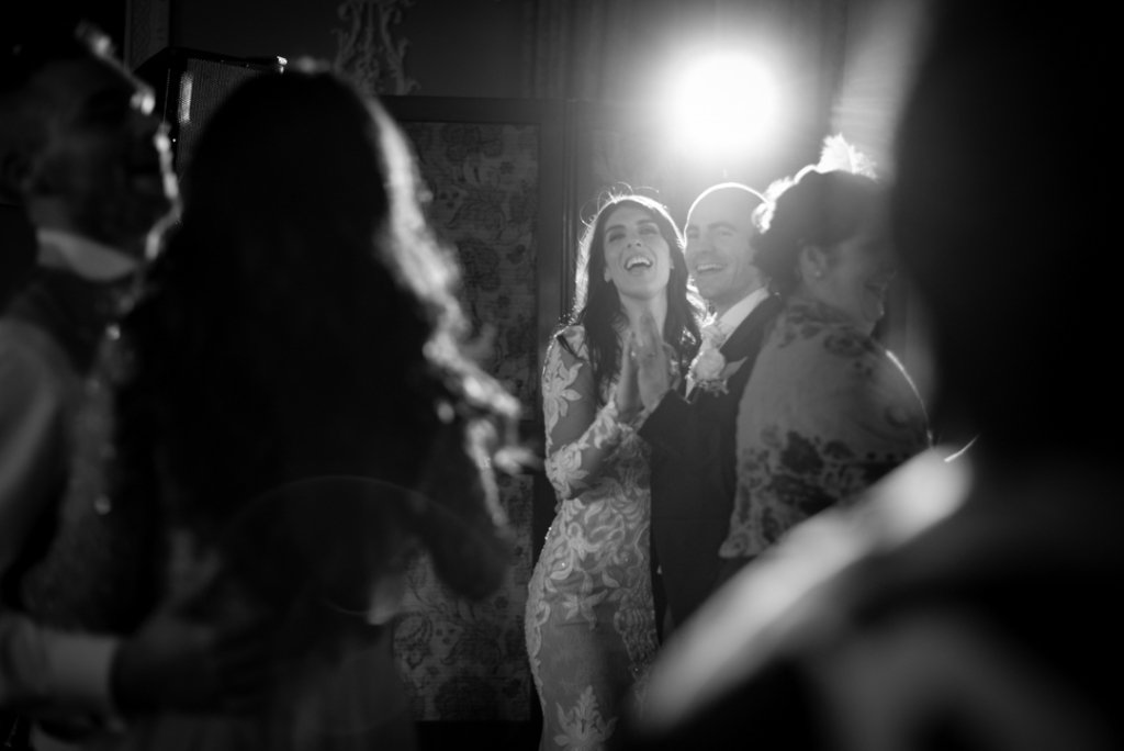 Bride and groom dancing on the dance floor with their guests