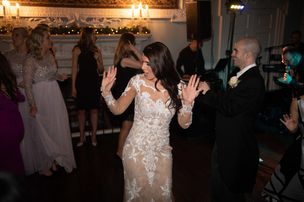 Bride with hands in the air dancing on the dance floor at Luttrellstown Castle