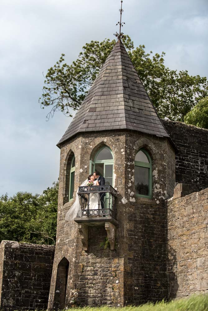 Bride and groom kissing on the Castle balcony at Lough Rynn Castle