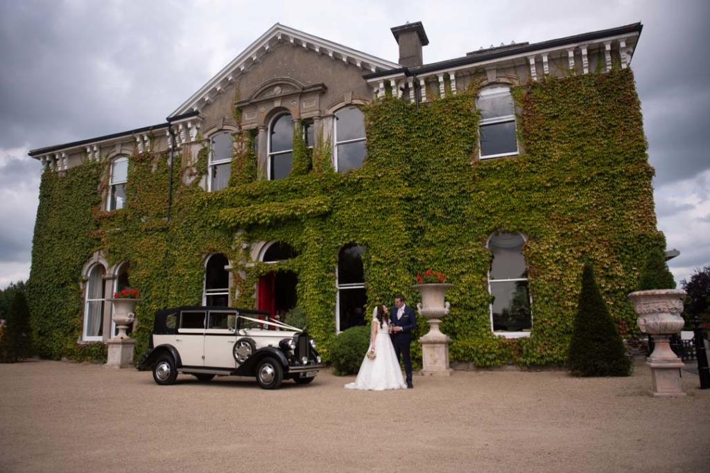 Bride and groom standing in front of the Lyrath Estate wedding venue