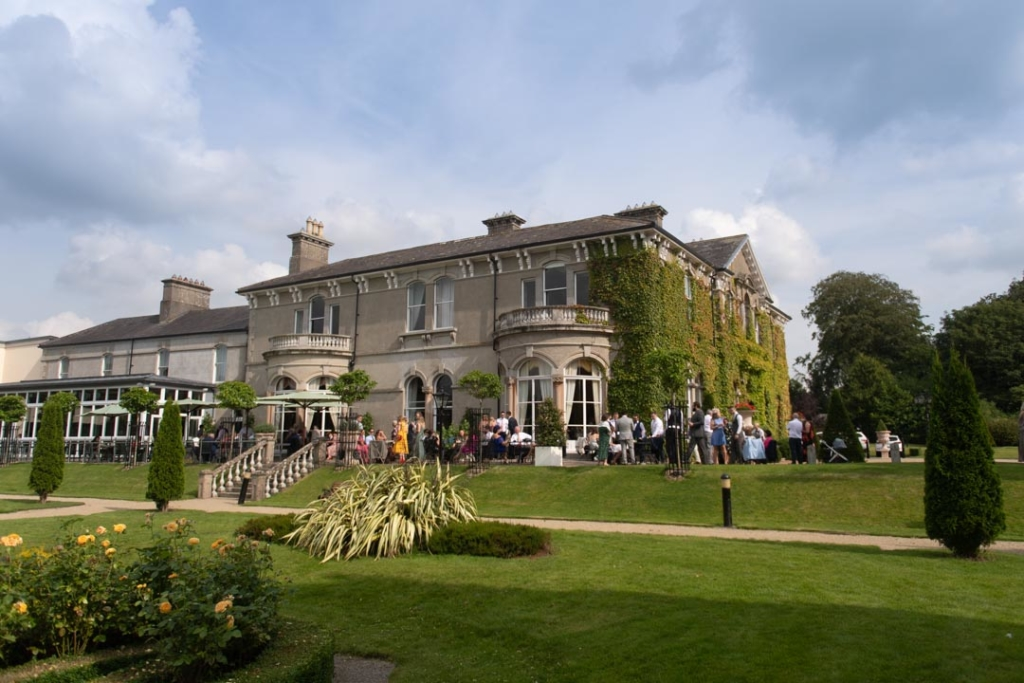 The guest outside at the drinks reception at the Lyrath Estate, one of the top wedding venues in Ireland