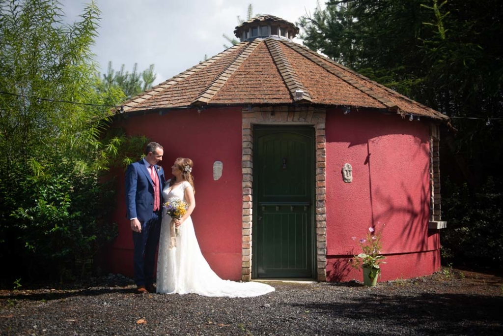 The bride and groom outside their honeymoon hut at the Mount Druid wedding venue in Ireland