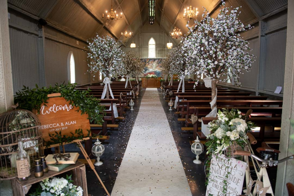 Inside the Tin Chapel set up for the wedding ceremony at the Mount Druid wedding venue