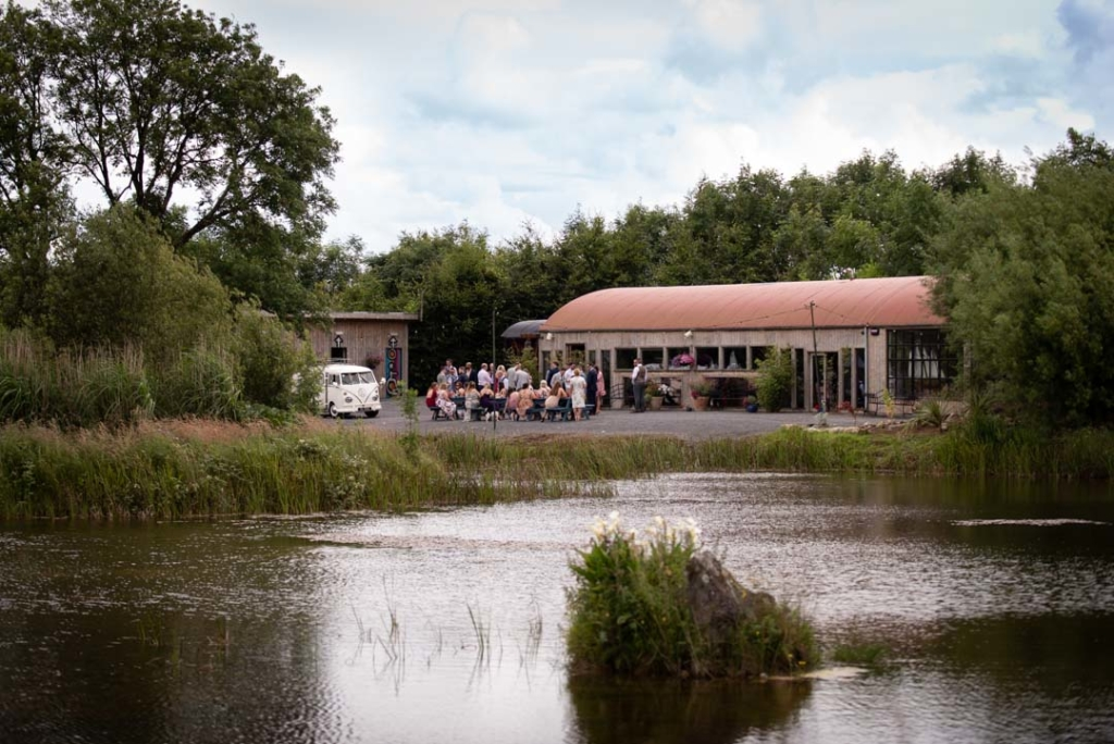 The wedding guests outside of the Boathouse at the drinks reception at Mount Druid