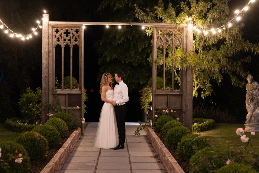Bride and groom standing under the fairy lights at Tinakilly House wedding venue