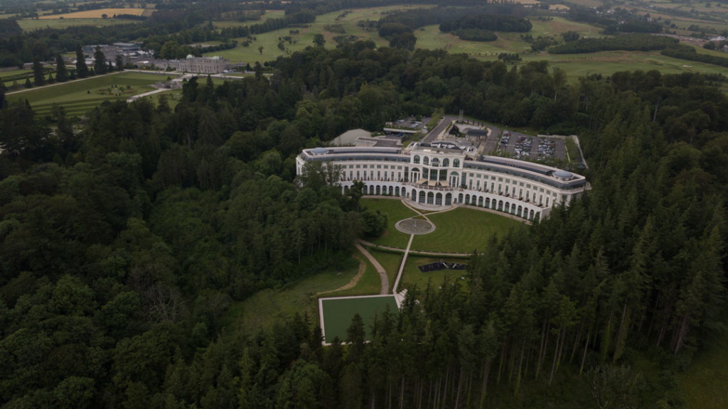 Aerial view of Powerscourt Hotel with Powerscourt House in the distance