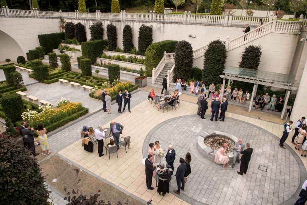 The wedding guests in the hidden garden at the Powerscourt hotel wedding
